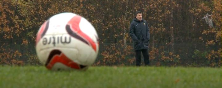 Dean Saunders near an oversized football