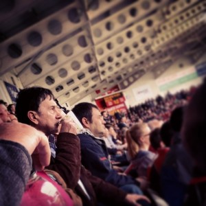 Doncaster Rovers fan drinking from a mug during a game