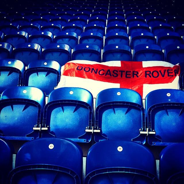 Colchester United v Doncaster Rovers: Doncaster flag on blue seats