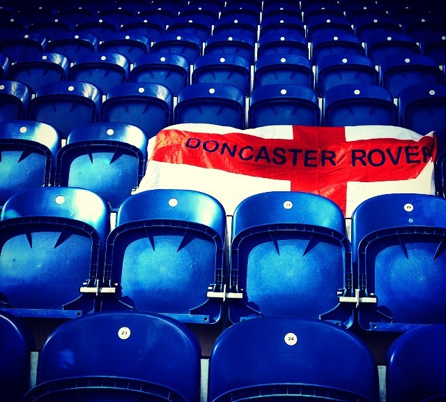 Colchester United v Doncaster Rovers: Doncaster flag on blue seats