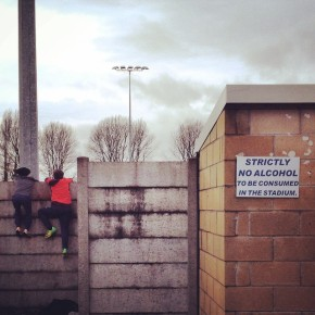 Children climb the fence to see into the ground ahead of Weston-Super-Mare versus Doncaster Rovers in the FA Cup