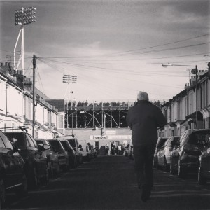 A man approaches Priestfield Stadium, just ahead of Gillingham versus Doncaster Rovers