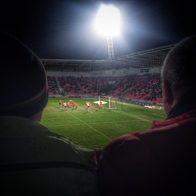 Supporters watch on as Doncaster Rovers host Bradford City at the Keepmoat Stadium