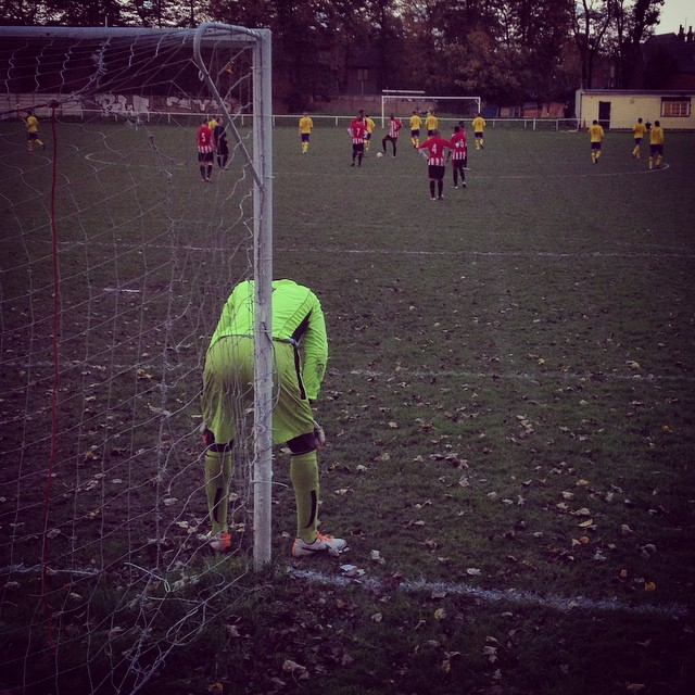 Disappointment for the Clapton goalkeeper as his team concede to FC Romania