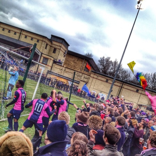 Dulwich Hamlet players and fans celebrate going 3-2 in front against East Thurrock