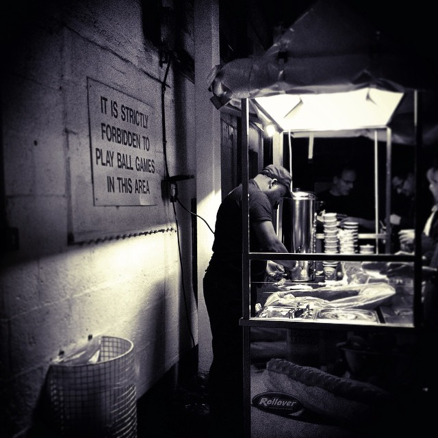 A man prepares half-time food at Leyton Orient vs Doncaster Rovers