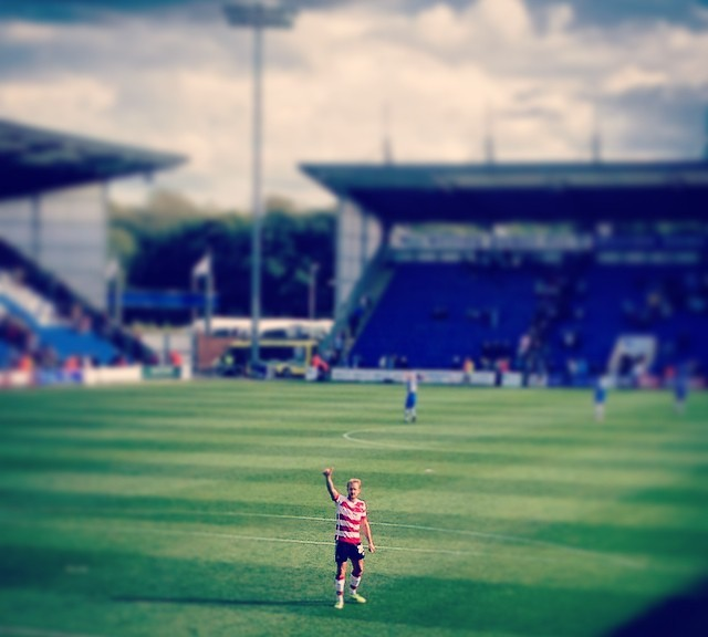 Jamie Coppinger salutes the travelling Doncaster Rovers fans after his team's victory at Colchester United