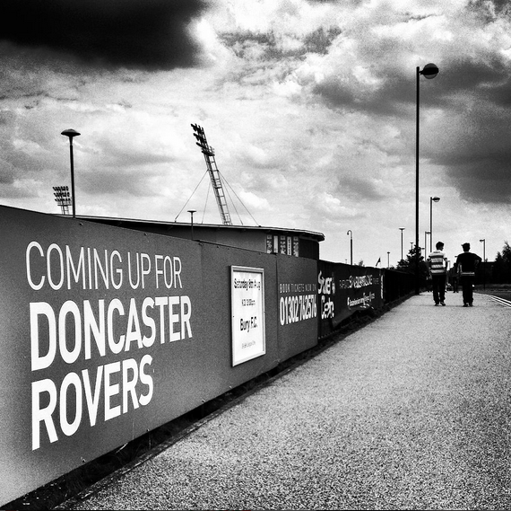 Two Doncaster Rovers fans arrive at the Keepmoat Stadium for Doncaster Rovers match versus Bury