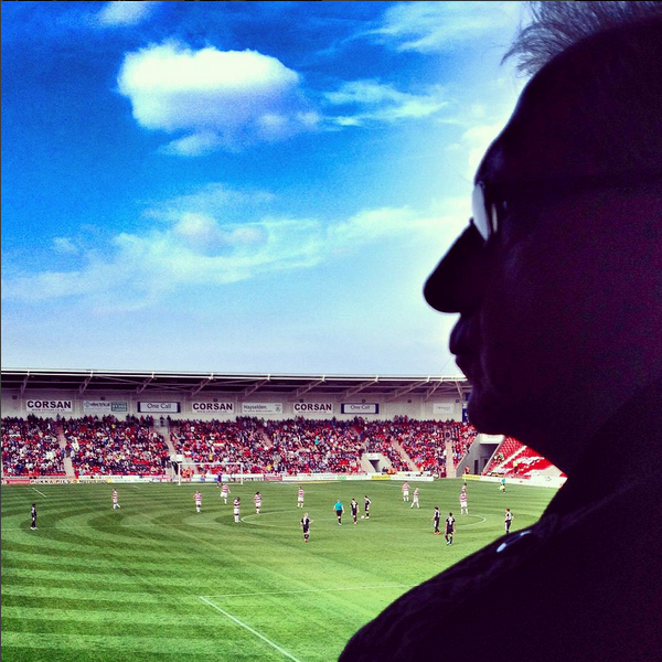 A supporter watches on as Barnsley prepare to kick off in their League One game against Doncaster Rovers at the Keepmoat Stadium