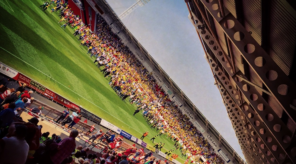 Burton Albion supporters invade the pitch at the Keepmoat Stadium after a 0-0 draw with Doncaster Rovers
