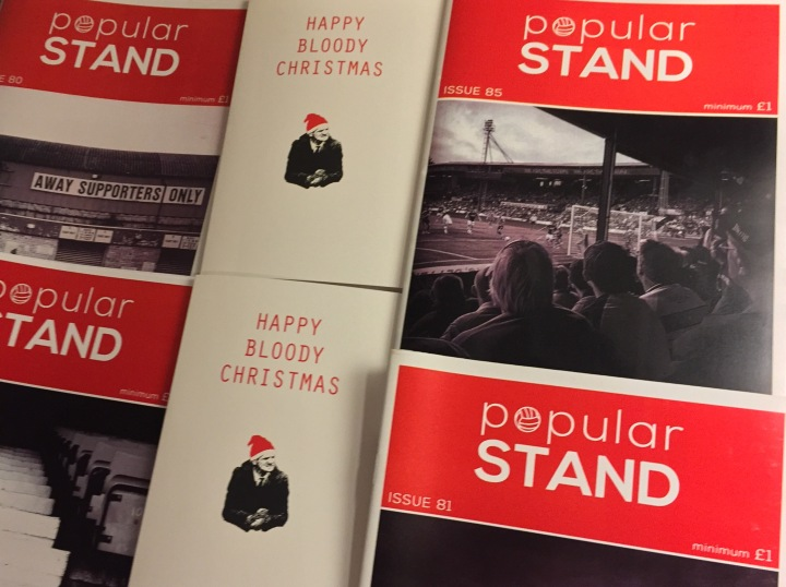 front covers of popular STAND fanzine and fanzine Christmas cards