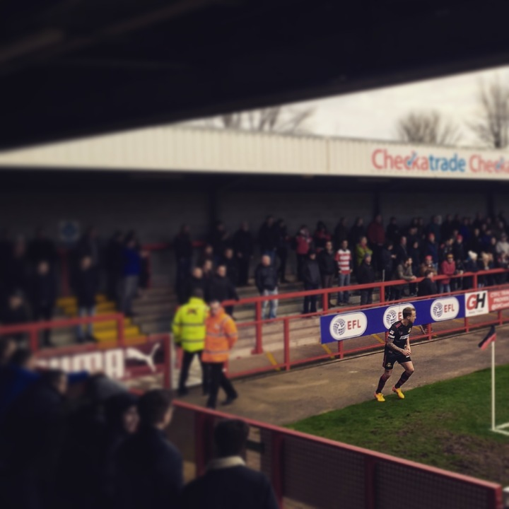 James Coppinger takes a corner in front of travelling Doncaster Rovers fans during their 0-0 draw at Crawley Town in League Two.