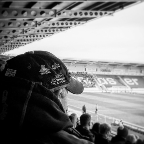 A Doncaster Rovers supporter watches on during his team's 2-0 win over Cheltenham Town at the Keepmoat Stadium