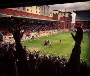 Doncaster Rovers players and fans celebrate after John Marquis scores his second goal during Rovers' 4-1 win away at Leyton Orient's Brisbane Road