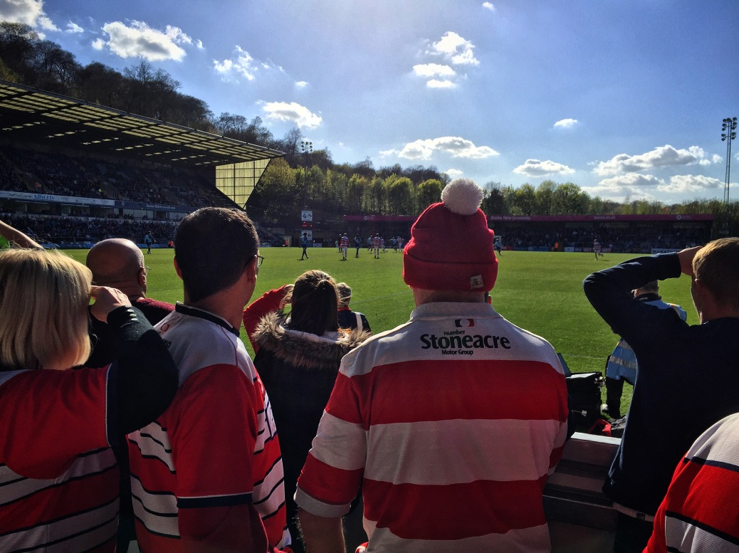 Doncaster Rovers fans watch the closing stages of their team's 2-1 defeat to Wycombe Wanderers at Adams Park