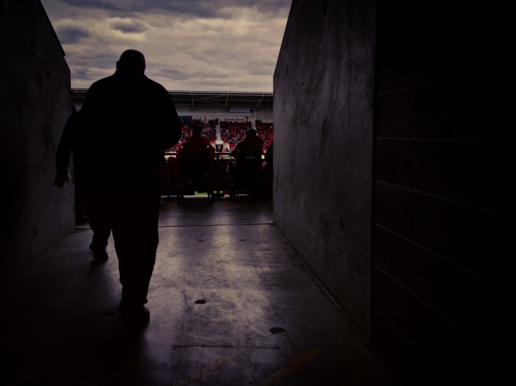 A Doncaster Rovers supporter heads into the Keepmoat Stadium for the second half of his team's 3-1 defeat to Exeter City