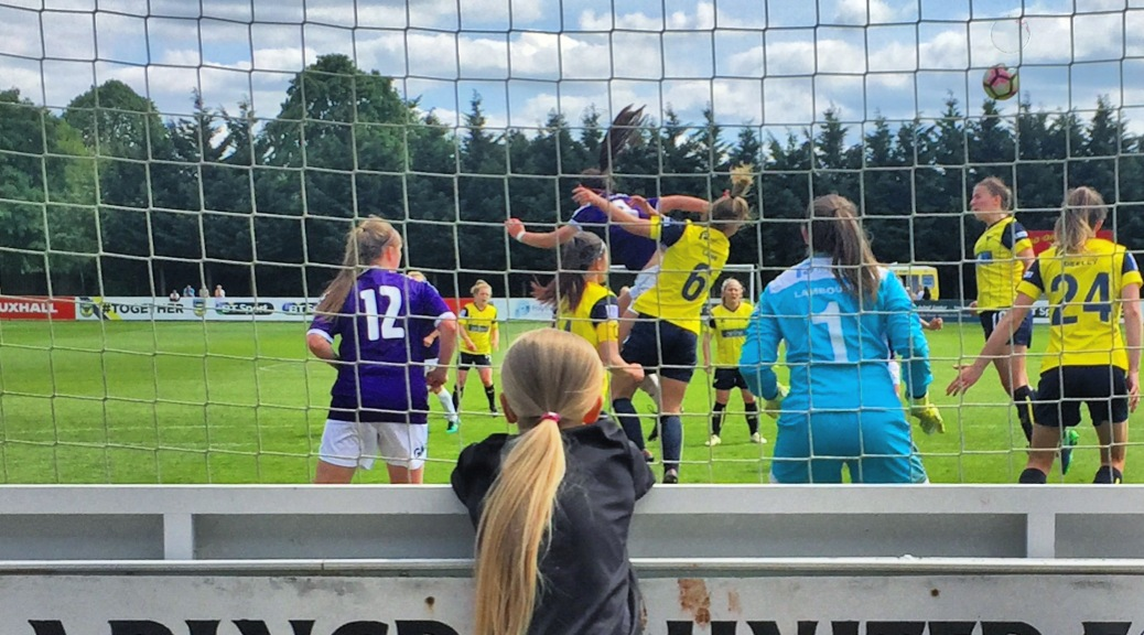 A young female fan watches a Doncaster Rovers Belles corner during their 4-0 win at Oxford United in FA Women's Super League 2