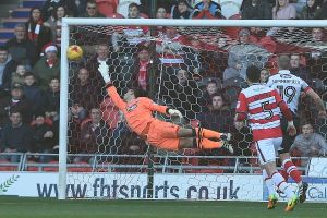 Grimsby Town's goalkeeper is unable to stop Liam Mandeville's free-kick finding the net at the Keepmoat Stadium to give Doncaster Rovers the lead
