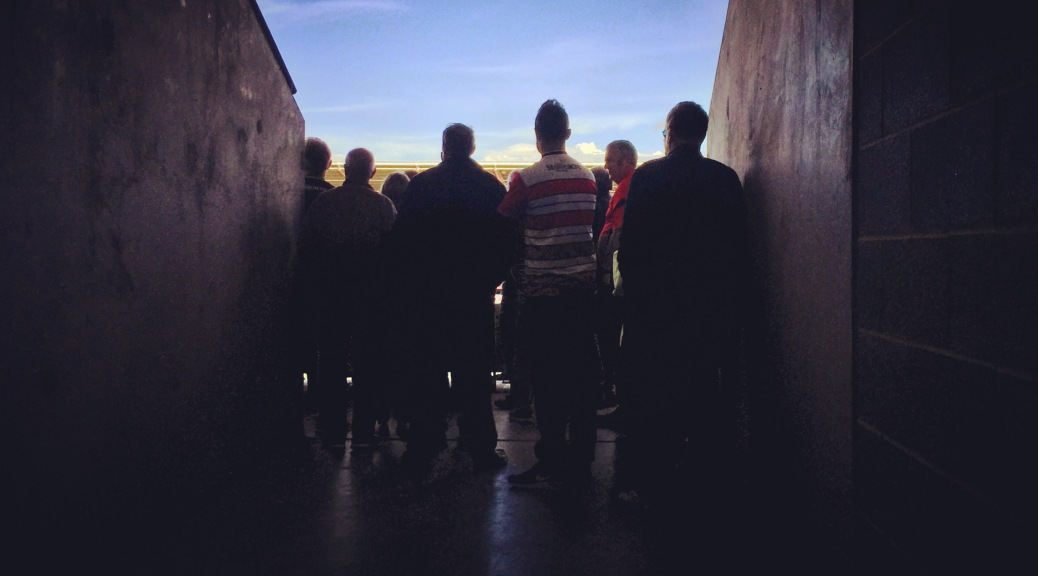 Doncaster Rovers supporters watch the final few minutes of their 0-0 draw with Gillingham at Keepmoat Stadium