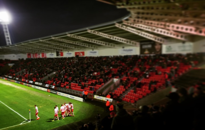 Doncaster Rovers players celebrate after their second goal against Milton Keynes in a 2-1 win at the Keepmoat Stadium