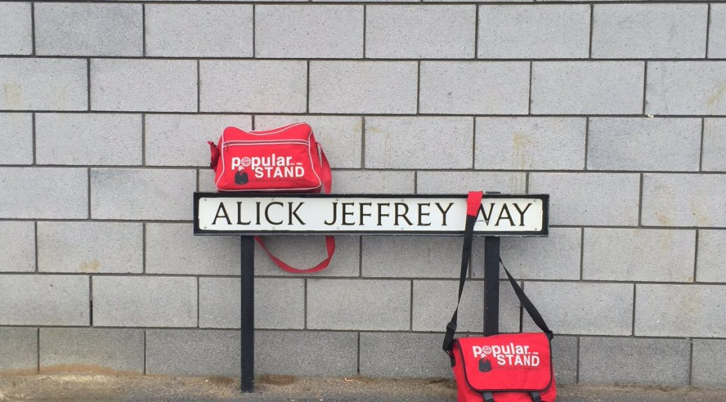 popular STAND fanzine bags hanging on the Alick Jeffrey Way sign outside Doncaster Rovers' Keepmoat Stadium ahead of their League One match with Plymouth Argyle