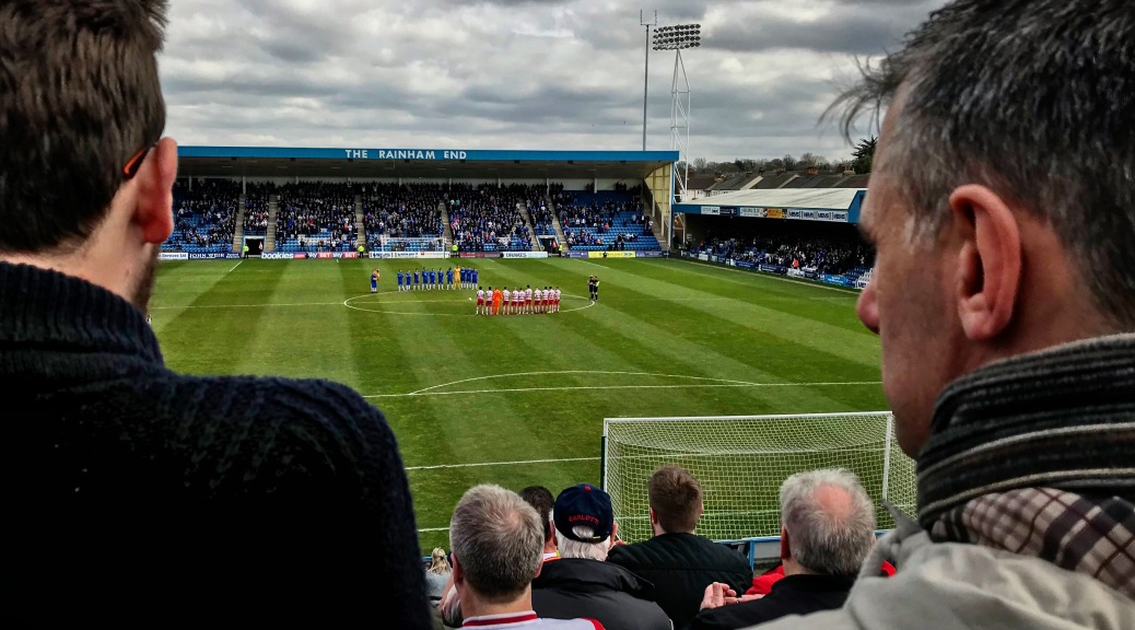 Doncaster Rovers supporters look on as their team line-up for a minute's applause for Ray Wilkins ahead of the League One match with Gillingham at Priestfield