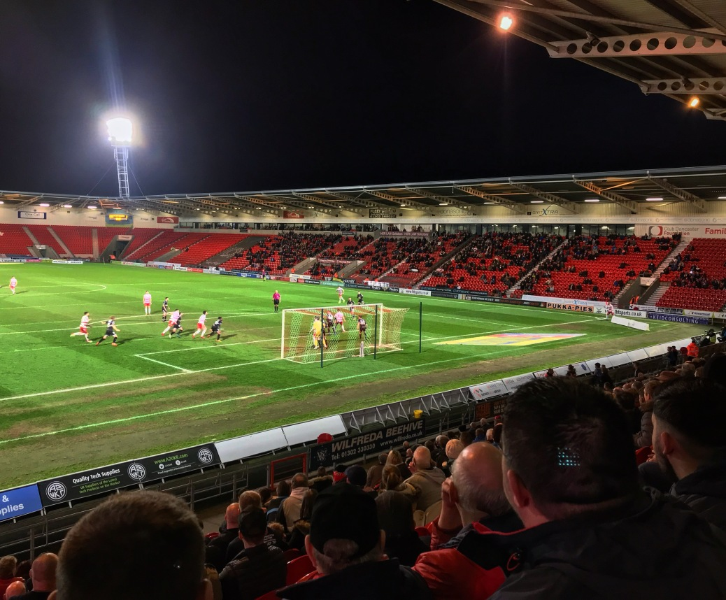 Doncaster Rovers supporters watch on as their team attack a corner during the second half of a 3-3 draw with Bury at the Keepmoat Stadium