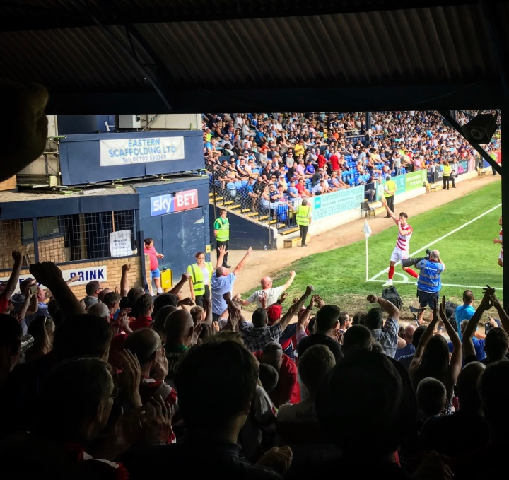 John Marquis celebrates in front of the Doncaster Rovers supporters after putting Rovers 1-0 ahead at Southend United