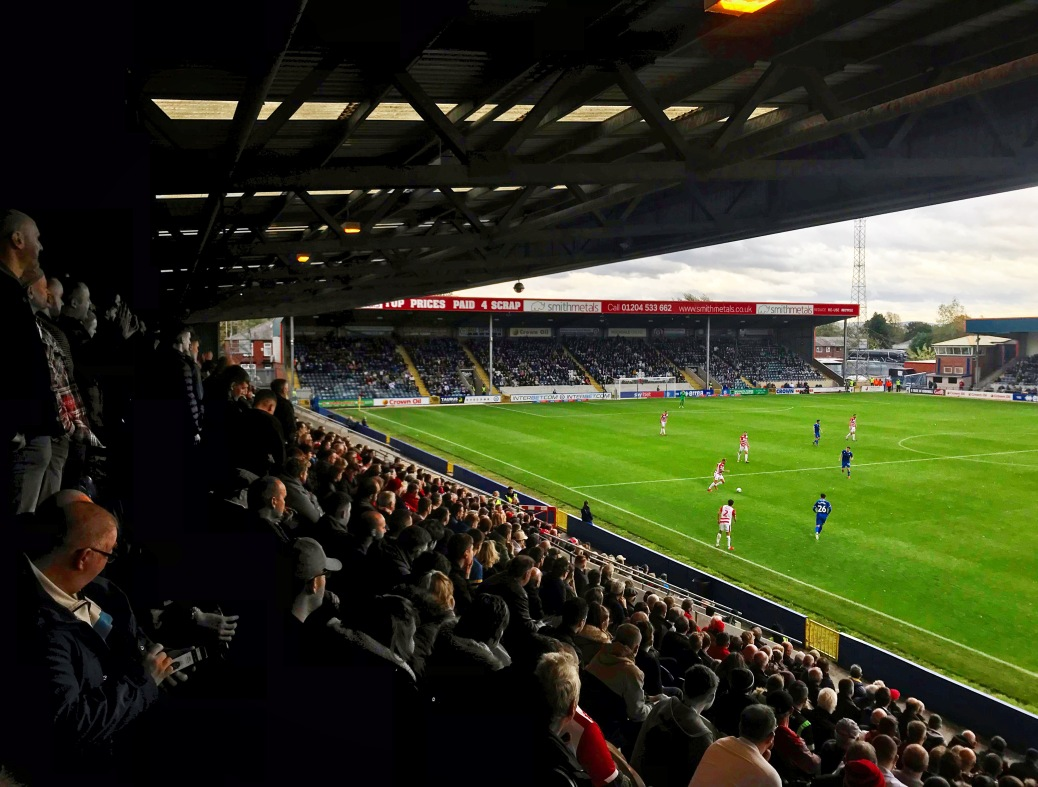 Doncaster Rovers fans at Spotland look on as their team plays out a 3-2 win away at Rochdale