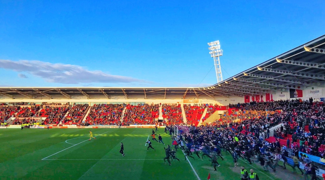 Supporters invade the pitch at the Keepmoat Stadium following Doncaster Rovers 2-0 victory over Coventry City to secure a League One play-off place.
