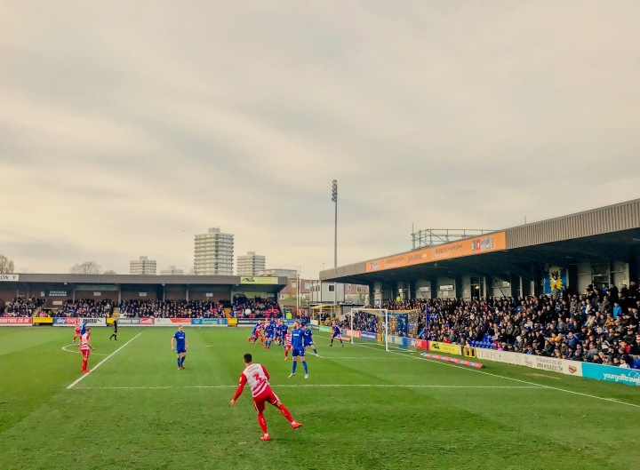 Danny Andrew takes a free-kick during Rovers defeat at Kingsmeadow in the League One fixture