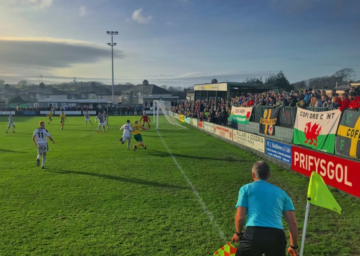 Home fans watch their side on the attack during the Welsh Premier League fixture at The Oval