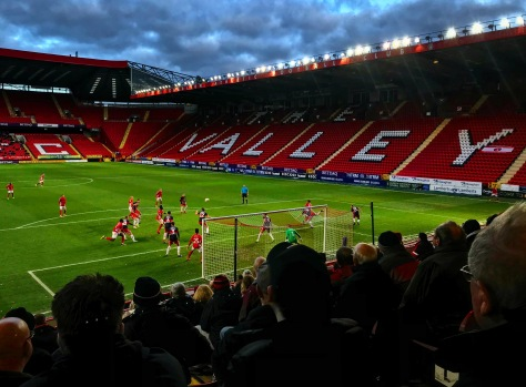 Empty home stands at The Valley as Rovers defend a corner in the FA Cup second round tie