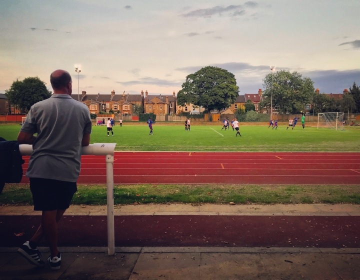 A spectator watches on at Ladywell Arena as the home team goalkeeper gathers a cross in the Southern Counties East League Division One match