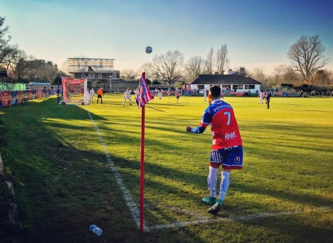 A Peckham Town player takes a corner kick during their 4-2 Kent County League Premier Division win over Kings Hill