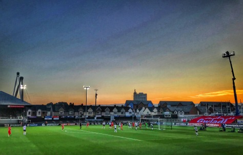 Wales on the attack as the sun sets during their 3-0 defeat to England in the Women's World Cup Qualifier at Rodney Parade