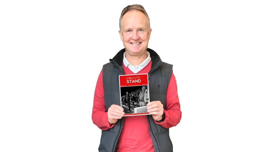 Sean O'Driscoll holds a copy of popular STAND fanzine