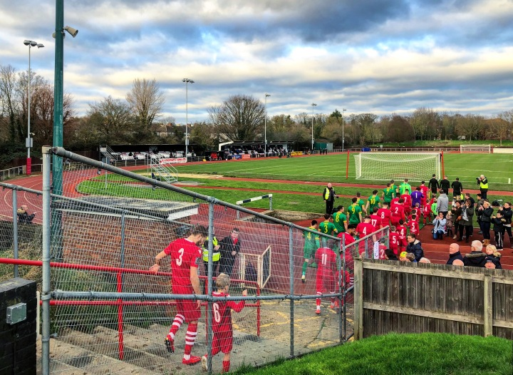 The players enter the field at Hornchurch Stadium for AFC Hornchurch v Horsham