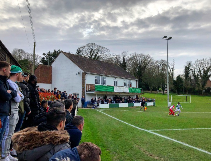 Corinthian supporters watch their team on the attack against Leighton Town in the FA Vase