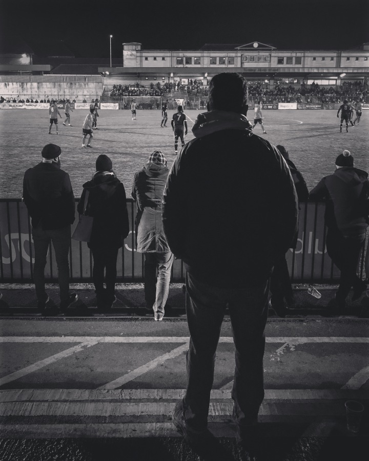 A Dulwich Hamlet fan watches their home game against Havant & Waterlooville