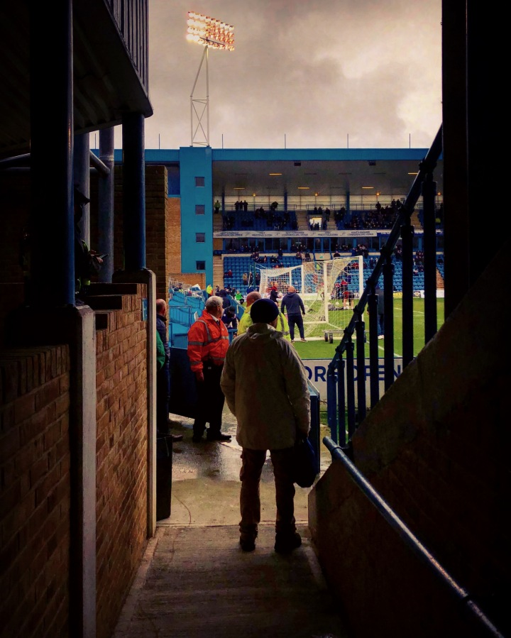 A Doncaster Rovers fan enters the away end at Gillingham's Priestfield