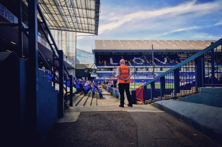 A steward watches on as Portman Road fills up for Ipswich Town against Doncaster Rovers
