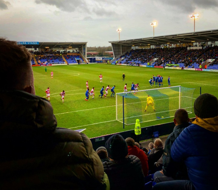 A view from the away end at Shrewsbury Town's New Meadow with Doncaster Rovers on the attack