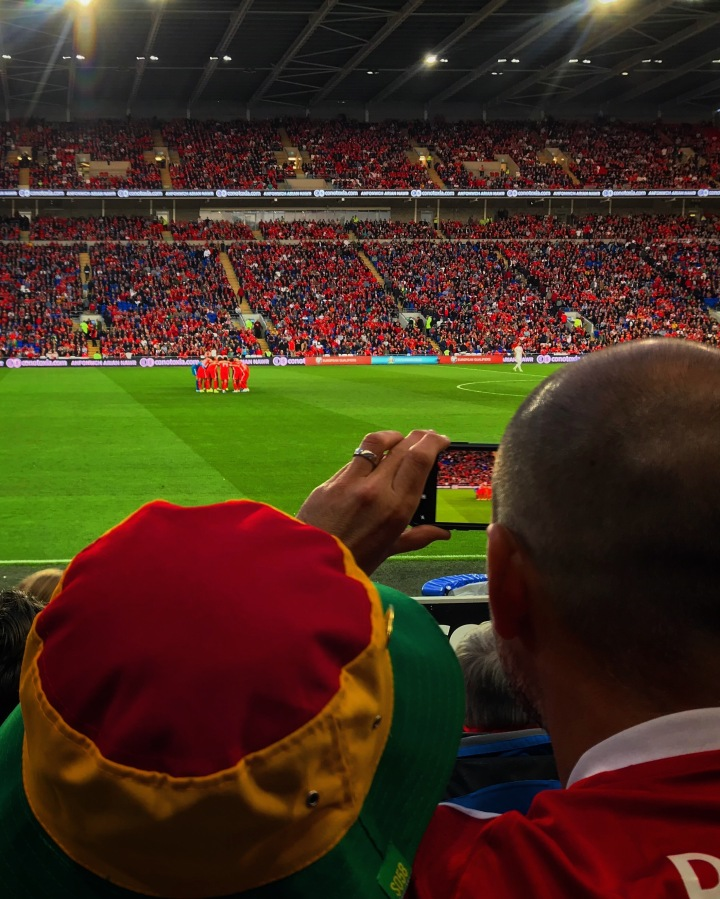 A supporter photographs the Wales' team's huddle before their Euro 2020 qualifier at home to Azerbaijan