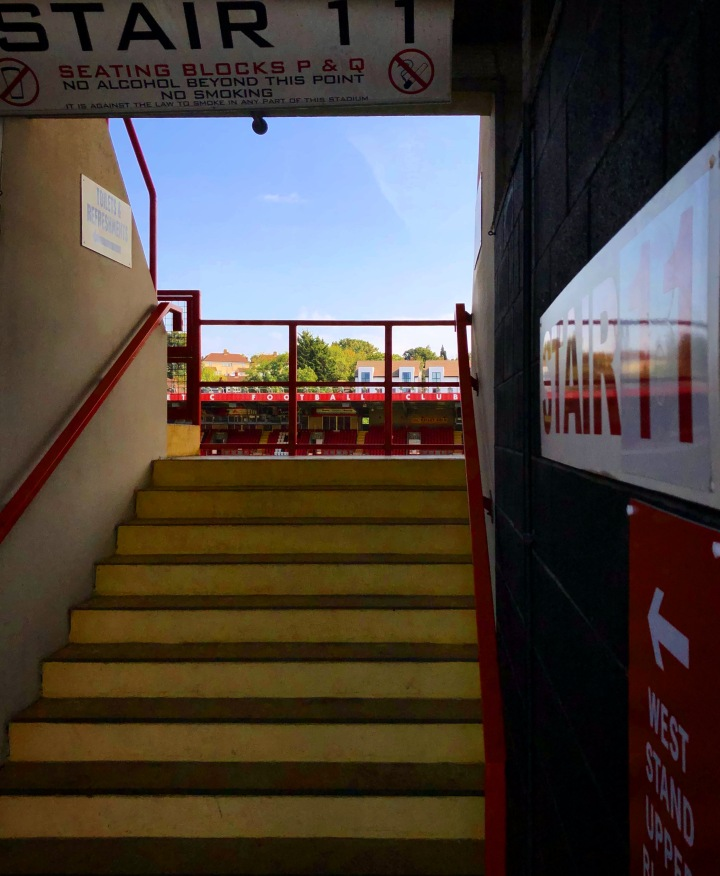 View from the concourse at The Valley, home of Charlton Athletic, looking up the steps towards the pitch.